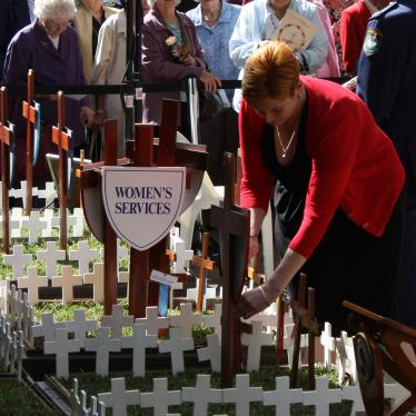 Marise planting a cross at the War Widows' Guild Field of Remembrance, St Andrew's Cathedral Sydney