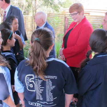 Marise talking with year six students from St John Vianney's Parish School about the Kokoda Memorial Garden they created.