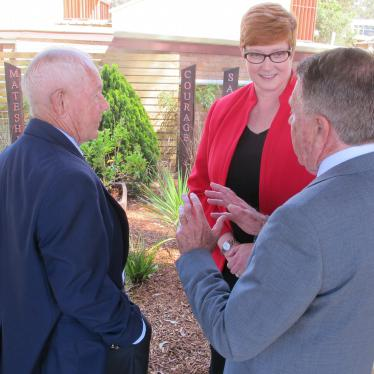 Marise talking with Kokoda Veteran Reg Chard (on the left) and Deputy Principal Tony Rose in front of the students Kokoda Memorial garden.